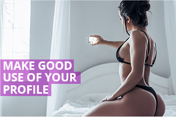 Woman on bed taking selfie